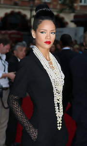 Rihanna layers many costume pearls to create this look.