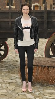 Eleanor Tomlinson showed her rocker edge with a classic leather jacket.
