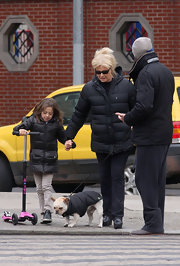 Ava Jackman kept warm in a black puffer jacket while out on a stroll with her family.
