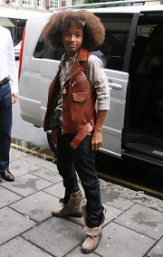 Jaden paired his denim jeans with a carmel vest.