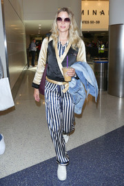 Jaime King was spotted at LAX looking pajama-chic in striped satin pants and a matching shirt.