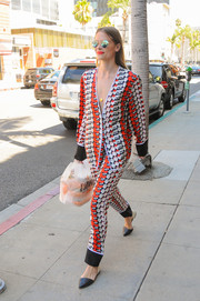 Jaime King cut a vibrant figure in a fruit-print pantsuit by Victoria Beckham while out and about.