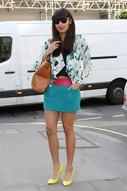 This bold pink and blue mini skirt showed of Jameela's lovely long legs to full-effect.