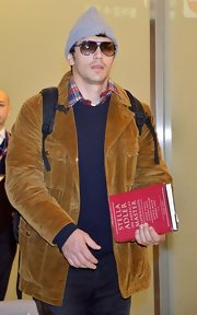 James Franco kept warm with a corduroy blazer while landing in Tokyo for the 'Oz: the Great and Powerful' premiere.