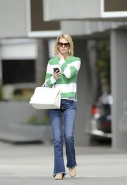 January Jones chose a green-and-white striped sweater for her casual but colorful daytime look.