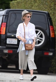 For her arm candy, January Jones chose a tan leather shoulder bag by Jason Wu.