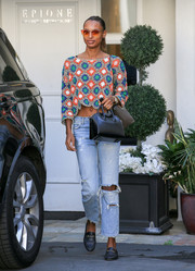 Jasmine Tookes finished off her outfit with casual black loafers.