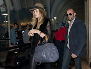 Rosie Huntington-Whiteley carried a dusty blue leather handbag while departing LAX.