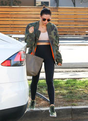 Jenna Dewan-Tatum toughened up her gym attire with a camo jacket by Alpha Industries for a day out in LA.