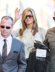 Jennifer Aniston looked sporty wearing these shield sunglasses while headed to 'Jimmy Kimmel.'