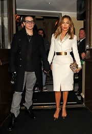 Jennifer Lopez stunned in a belted shawl-collar dress.