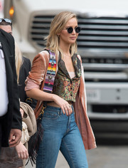 Jennifer Lawrence headed to 'Jimmy Kimmel Live' wearing a pair of round sunglasses by Oliver Peoples The Row.