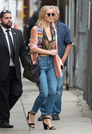 Jennifer Lawrence styled her casual look with a pair of chunky-heeled sandals by Jimmy Choo.