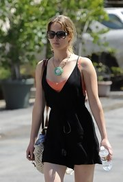 Jennifer looked stylish and cozy in this gauzy textured romper layered over an orange lace cami.