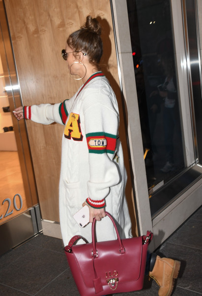 Jennifer Lopez was spotted out in LA carrying a personalized fuchsia leather tote by Valentino.