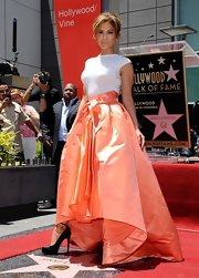 Jennifer Lopez looked totally glam all the way down to her towering black platform pumps when she was honored with a star at the Hollywood Walk of Fame.