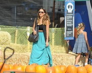 Jessica Alba visited a pumpkin patch wearing a sleeveless black cardigan over a bralet.