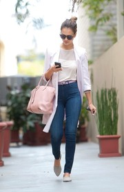Jessica Alba styled her jeans with a crisp white coat.