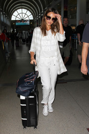 For her shoes, Jessica Alba chose classic white canvas sneakers by Converse.