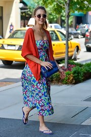 Jessica Alba looked summery and chic in this aloha print strapless dress.