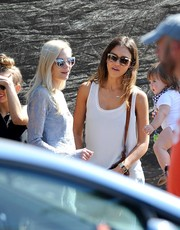 Jessica Alba was spotted at a pumpkin patch wearing Burberry wayfarers with light-colored rim.