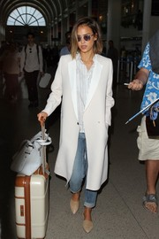 Jessica Alba was spotted at LAX looking sleek in her white Gerard Darel coat.