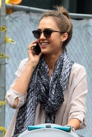 Jessica Alba layered a Spun by Subtle Luxury snakeskin-print scarf over her nude blouse for a chicer finish.