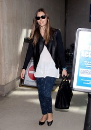 Jessica Biel looked edgy in a structured black leather jacket as she made her way through LAX.