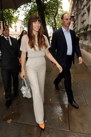 Jessica Biel complemented her chic outfit with a metallic silver purse by Fendi.