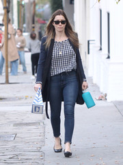 Jessica Biel kept it relaxed in a checkered peasant blouse while out on a stroll.