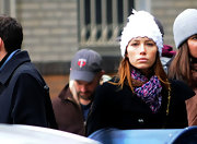 Jessica's white, pompom beanie is a cute accessory for fall in the cool east coast weather.