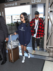 For her travel bag, Jhene Aiko chose a luxurious Louis Vuitton rollerboard.
