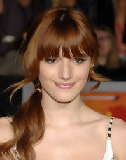 Bella Thorne attended the premiere of 'John Carter' wearing a glittery pale pink gloss.