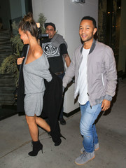 Chrissy Teigen donned a loose gray V-neck mini by Raquel Allegra for a dinner out with the hubby.