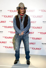 Johnny wears denim on denim in this unique red carpet look.