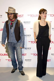Johnny wears a brown pinstripe vest over a denim button up for this unique collection of styles.