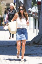 Jordana Brewster paired her top with a frayed denim skirt.
