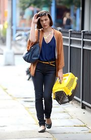 Milla's skinny jeans kept her look casual for set.