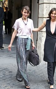 Milla's light pink loose blouse looked light and airy when paired with sequined wide-leg trousers.
