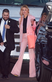Julia Roberts left 'Jimmy Kimmel Live' wearing a pink bell-bottom pantsuit.