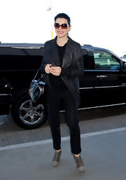 Julianna Margulies toughened her airport look with a shawl collar leather jacket and futuristic booties.
