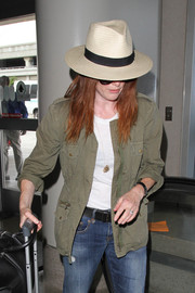 Julianne Moore kept a low profile with a straw hat as she made her way through LAX.