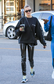 Hailey Baldwin teamed her outfit with a pair of Adidas Yeezy 700 Wave Runner sneakers.