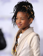You can always count on budding super star Willow Smith to show off an inventive hairstyle. The child prodigy styled her locks into a small micro braided ponytail. A stylish Chanel chain completed her winning look.