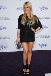 Cassie channeled 80's rocker in a bedazzled sweater tunic dress at the premiere of 'Justin Bieber: Never Say Never.'