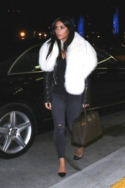Kim Kardashian made a grand entrance at LAX wearing a luxurious white fur scarf.