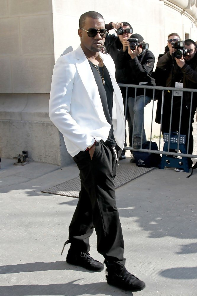 7cee978673e3 Kanye looked street chic in a crisp white blazer and black slacks at the Chanel  fashion