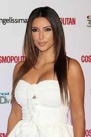 Kim's sleek locks had lovely front layers to give more texture to her look.