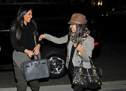 Kourtney paired her leopard scarf and fedora hat with a leather studded shoulder bag.