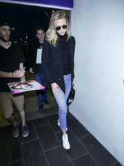 Karlie Kloss opted for a pair of white Adidas leather sneakers to finish off her outfit.
